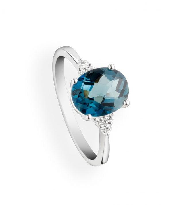 anillo topacio central y diamantes