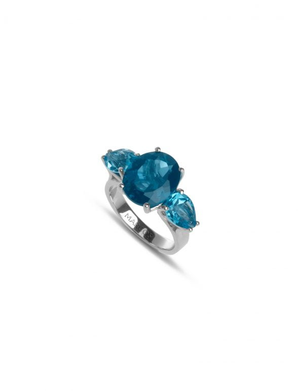 sortija joyería marcos oro blanco con topacio london blue oval y topacio suizo pera